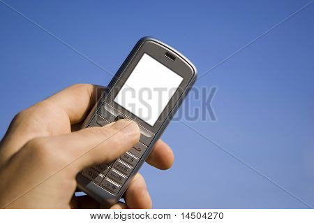 White screen on mobile phone to write it on whatever you want! Mobile in the hand over blue sky