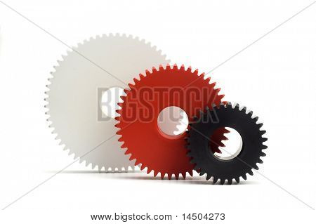 Three different coloured gears in ascending order. Working in progress and cooperation concept.