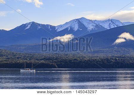 yachting sailing boat in lake te anau fiordland national park south island new zealand important traveling destination