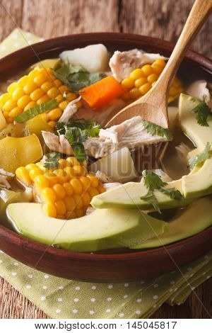 Traditional Colombian Ajiaco Soup Close Up In A Bowl. Vertical