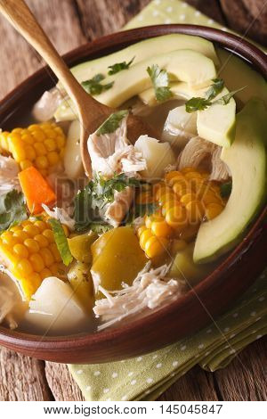 Colombian Cuisine: Ajiaco Soup Close Up In A Bowl. Vertical
