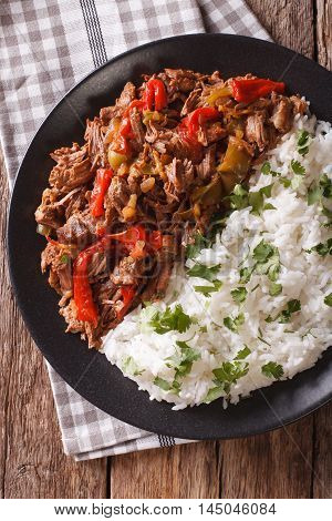 Cuban Cuisine: Ropa Vieja Meat With Rice Garnish  Close-up. Vertical Top View