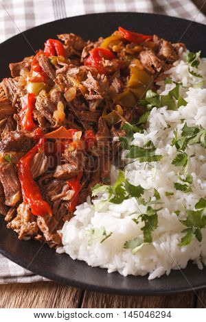 Latin American Cuisine: Ropa Vieja With Rice Close-up. Vertical