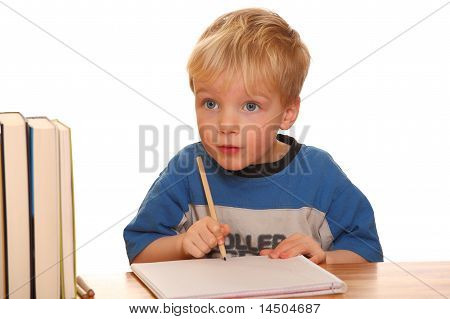 Toddler with pen and paper