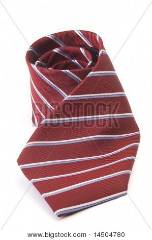 Red striped business tie rolled up over white background
