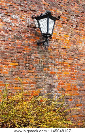 Lantern on a brick wall in the old town