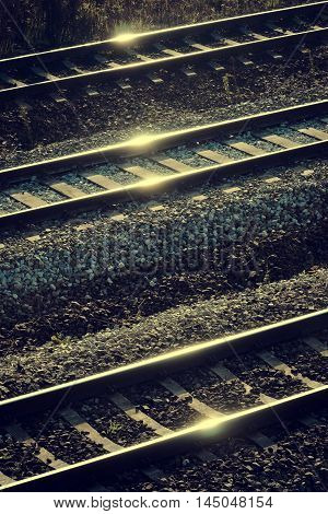 Sunny specks of light on railway rails