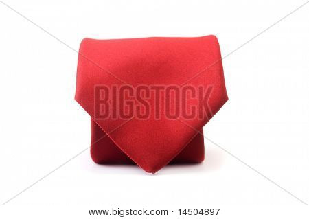 Red silk business tie rolled up like an envelope over white background