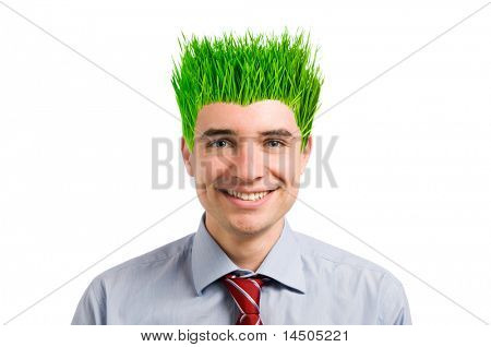 Happy young businessman smiling while looking at camera with his new vivid green grass hair. Green business concept