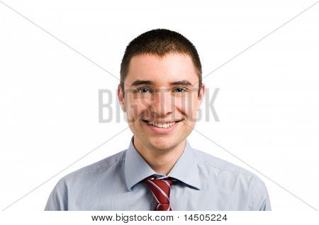 Portrait of smiling young businessman looking at camera. Isolated on white background
