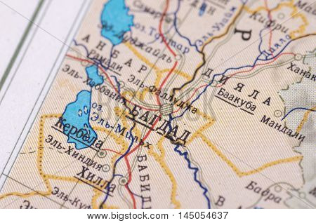 Baghdad city on old USSR map. Selective focus.