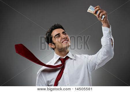 Happy businessman with bundle of euro money, good business!