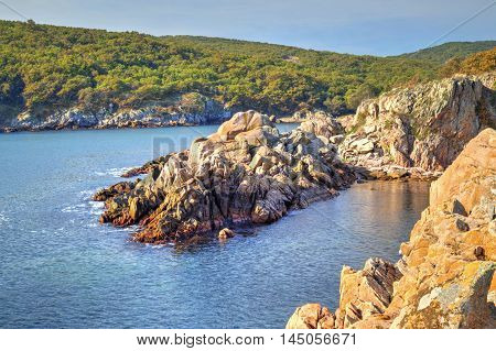 Beautiful landscape on rocky shore and blue sky
