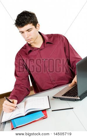 Young busy man studying and working on his laptop with note pad isolated on white background