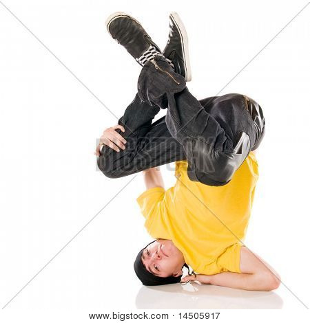 Young happy breakdancer standing upside down on arm and head