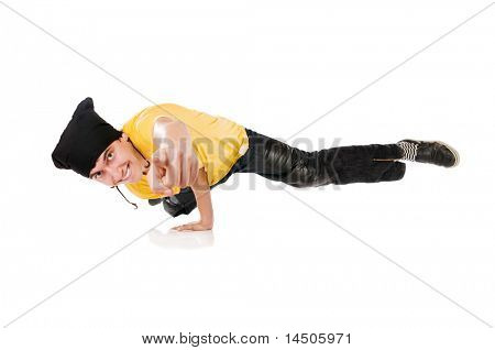 Young happy breakdancer pointing the index finger at you, while standing on one hand!