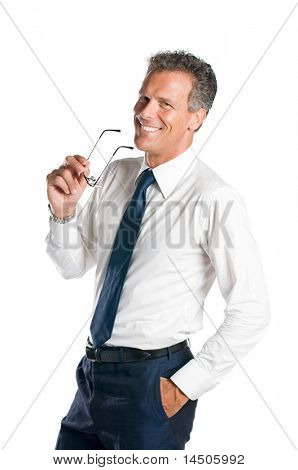 Smiling senior businessman holds a pair of glasses, isolated on white background