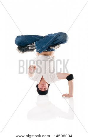 Young happy breakdancer posing upside down and pointing the index finger at you!