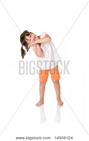 Little cute baby girl jokes to pretend to be sleeping isolated on white background