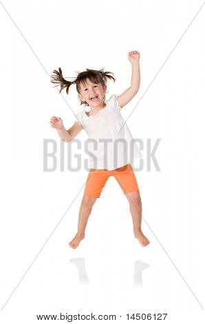 Cute little girl jumping with joy isolated on white background
