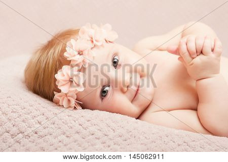 portrait of caucasian newborn with pink flower headband