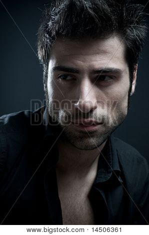 Handsome latin stylish man looking away. Fine art portrait