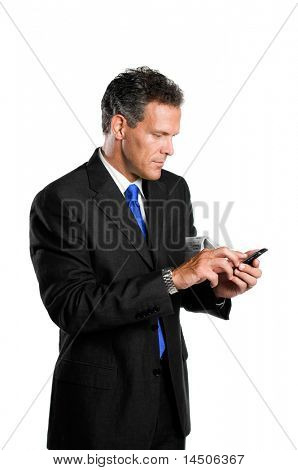 Happy absorbed mature businessman looking and dialing at his palmtop isolated on white background
