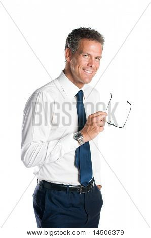 Mature man smiling while holding a pair of glasses isolated on white background
