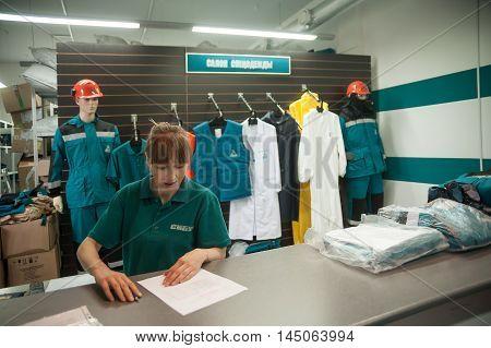 Tobolsk, Russia - July 15. 2016 Sibur company Storekeeper gives overalls