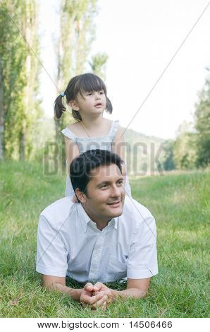 Father and daughter looking away with curiosity