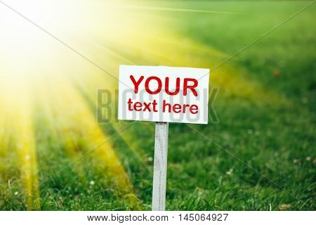 your text here banner on green grass background, yellow sunshine