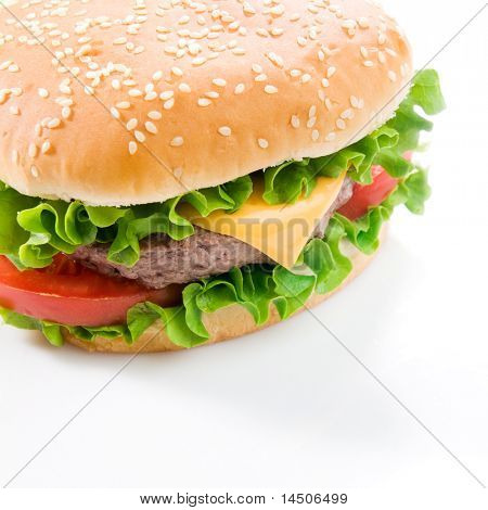 Big fresh delicious hamburger isolated on white background. Professional studio image