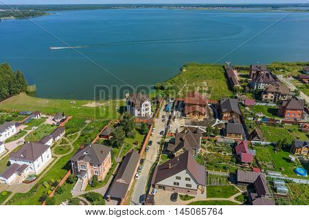 Borovskiy, Russia - August 3, 2016: Birds eye view onto residential district and beach on shore of Andreevskoe lake. Tyumen region