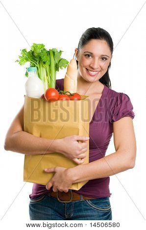Young Woman holding eine Lebensmittelgeschäft Tasche voller frische und gesunde Lebensmittel isolated on white background