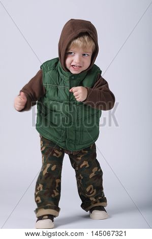 photo of little fighting boy on white