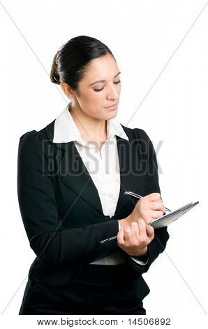 Beautiful business woman taking notes on her clipboard isolated on white background