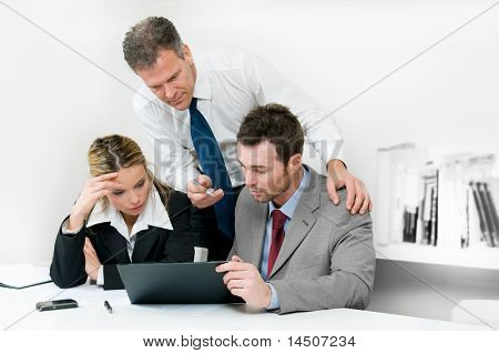 Business colleagues working hard together during a meeting in office
