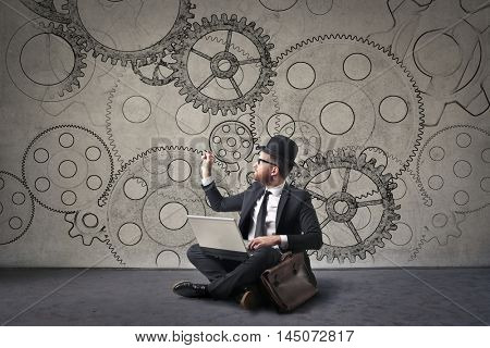 English businessman drawing gears