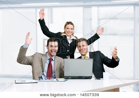 Happy smiling business team celebrate their new success in their modern office
