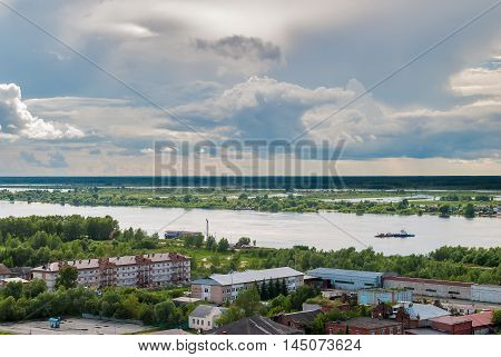 Tobolsk, Russia - July 15, 2016: Little ferry is transported through Irtysh river