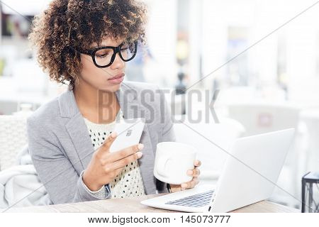 Elegant African American Woman Drinking Coffee, Working.
