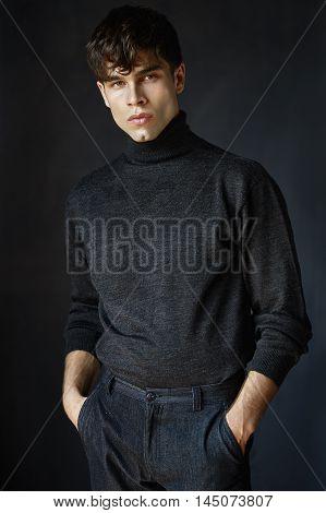 Beautiful portrait of fashion guy on gray background.
