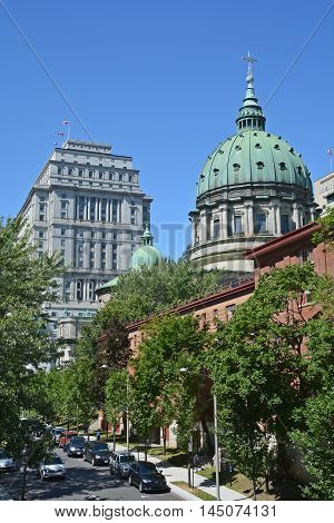 MONTREAL QUEBEC CANADA AUGUST 30 2016: Downtown Montreal Sunlife and Cathedral-Basilica of Mary, Queen of the World Cathedral