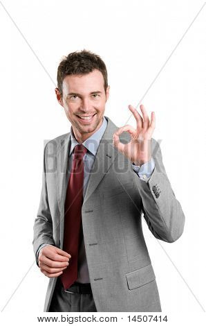 Happy satisfied business man with okay hand sign isolated on white background