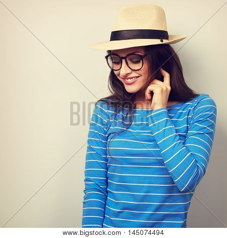 Fun Young Thinking Woman Looking Down In Glasses And Straw Hat. Toned Closeup Portrait