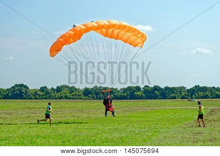 Kharkiv Ukraine - August 20 2016: Skydiver landed after the jump at the airfield Korotych Kharkov region Ukraine on August 20 2016