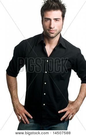 Stylish young latin man posing and looking at camera isolated on white background