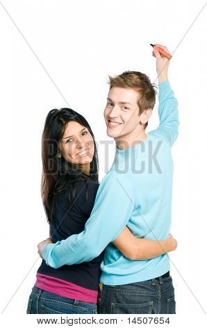 Happy young couple writing on white board with space for your text, isolated on white background
