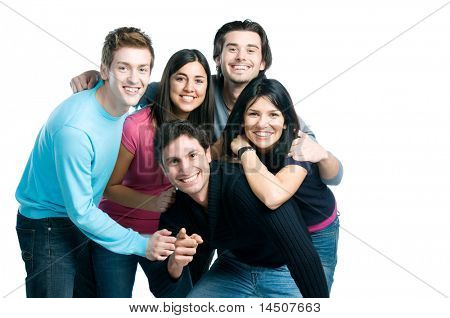 Happy smiling group of young friends standing and embracing together isolated on white background with copy space