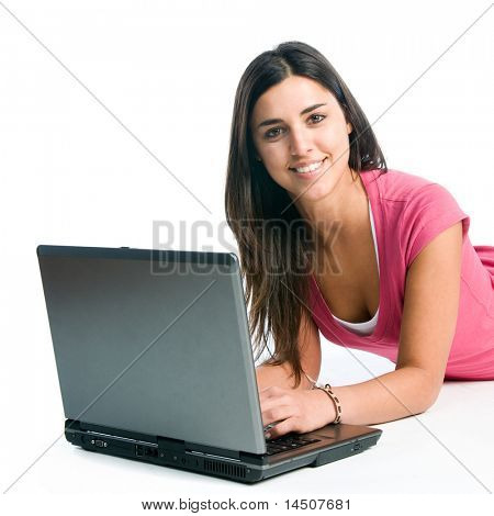 Young latin smiling woman working on laptop isolated on white background